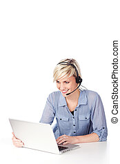 Blond Woman With Headset Looking At Laptop - Happy and...
