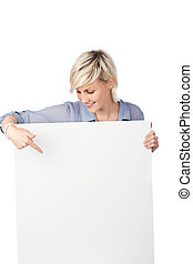 Blond Woman Pointing At White Sign