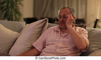 zapping - middle age man watching television and zapping...