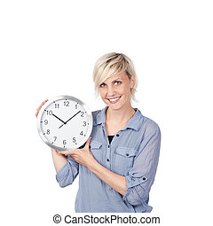 Smiling Blond Woman Holding Clock - Portrait of a smiling...