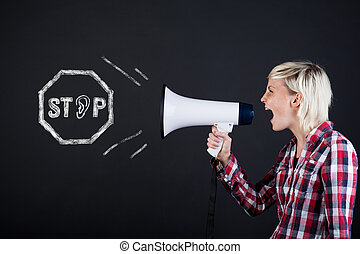 Side View Of Woman Yelling Into Megaphone - Side view of a...