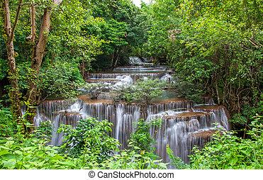 Waterfall in deep rain forest jungle. (Huay Mae Kamin...