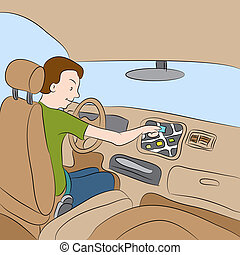 Car GPS Navigation - An image of a man using his car GPS...