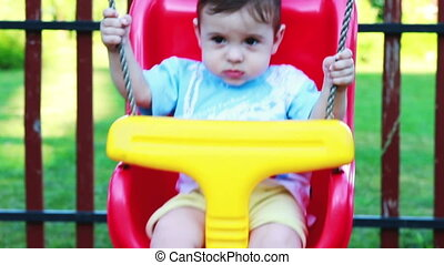 Little baby boy swinging