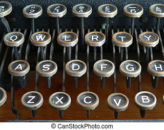 type writer - focus on the qwerty keys of an old fashioned...