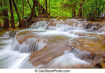 Waterfall in deep rain forest jungle. (Huay Mae Kamin...