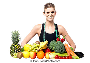 Slim fit girl with fresh fruits and vegetables - Female...