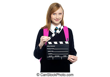 School girl with a clapperboard - Pretty kid in uniform with...