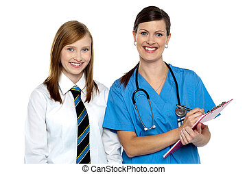 High school girl in doctors clinic - Smiling lady doctor...