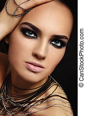 Beauty with smoky eyes - Young beautiful tanned woman with...