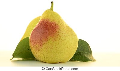 Two pears rotating on white background