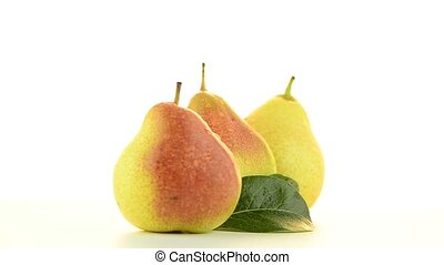 Three pears rotating on white background