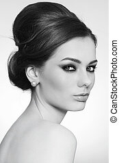 Beauty with hair bun - Black and white portrait of young...