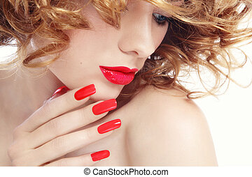Manicure and lipstick - Close-up portrait of young beautiful...
