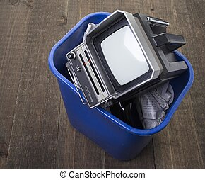 Tossing out the old tv - An old portable television in the...