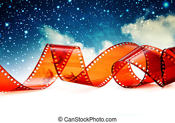 Film strip - Photo film strip against blue sky background
