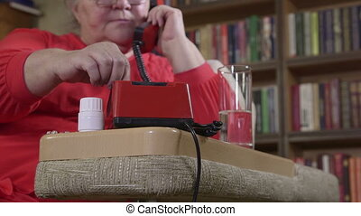 Mature woman with pills dials the phone number