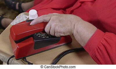 woman doing the emergency call - Sick senior woman doing the...