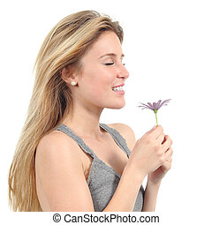 Beautiful woman smelling a lilac daisy isolated on a white...