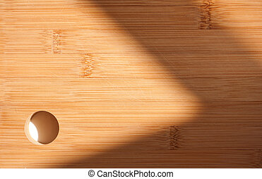 Sunlit cutting board. - Sunlit cutting board with shadow...