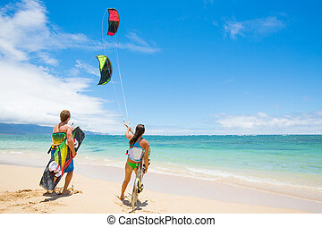 Kite Surfing - Kiteboarders on Beautiful Beach