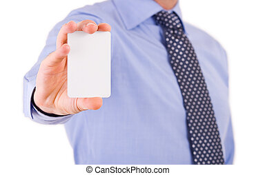 Businessman showing blank card.