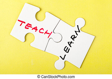 Teach and learn words written on two pieces of puzzle