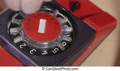 Dialing phone number - Female finger dialing number on an...