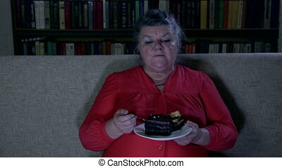 watching tv show - Fat senior woman watching tv show and...