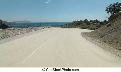 Drive on coastal road - Car driving on winding coastal road...
