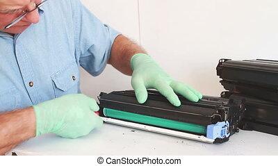 Hands repairing toner cartridge