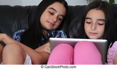 Teenage girls using tablet computer - Two happy teenage...