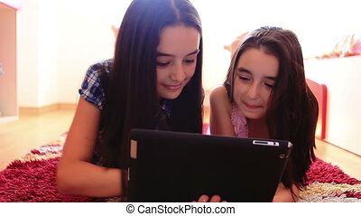 Girls having fun using tablet pc