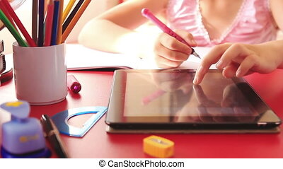 Girl doing homework on tablet pc