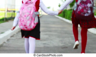 Little students going to school - Little girls going to...
