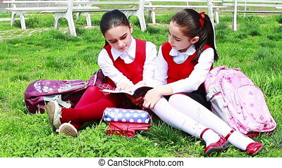 Back to School - College students girls learning together