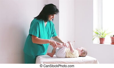 Physiotherapist with baby