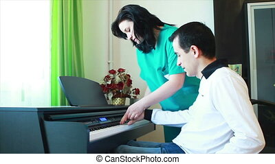 Therapy playing piano - Physical Therapy for young man in...