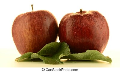 Two apples rotating on white background