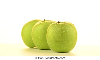 Three apples rotating on white background.