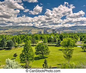 City park in Boise Idaho with the city and mountains -...