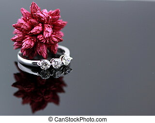 Engagement Ring - diamond engagement ring closeup with red...