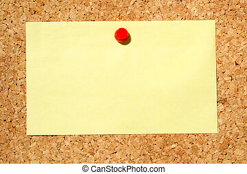 A yellow note held on a cork notice board with a red pushpin...