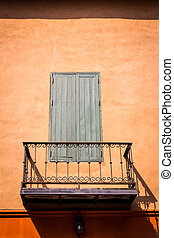 vintage gray wooden window and balcony