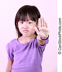 girl say no - A little girl holds out her hand to stop