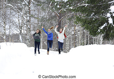 Girls run on the forest path