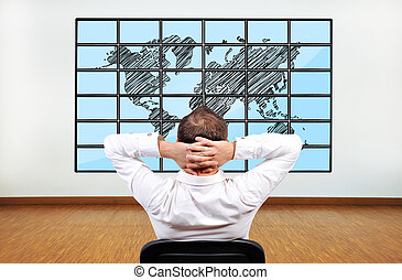 world on flat panels - businessman looking at map of world...