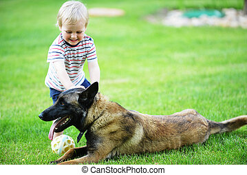 little boy with dog