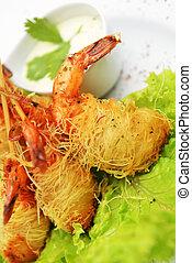 fried shrimp - Deep fried shrimp on lettuce leaves with...