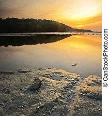 single stone during sunrise
